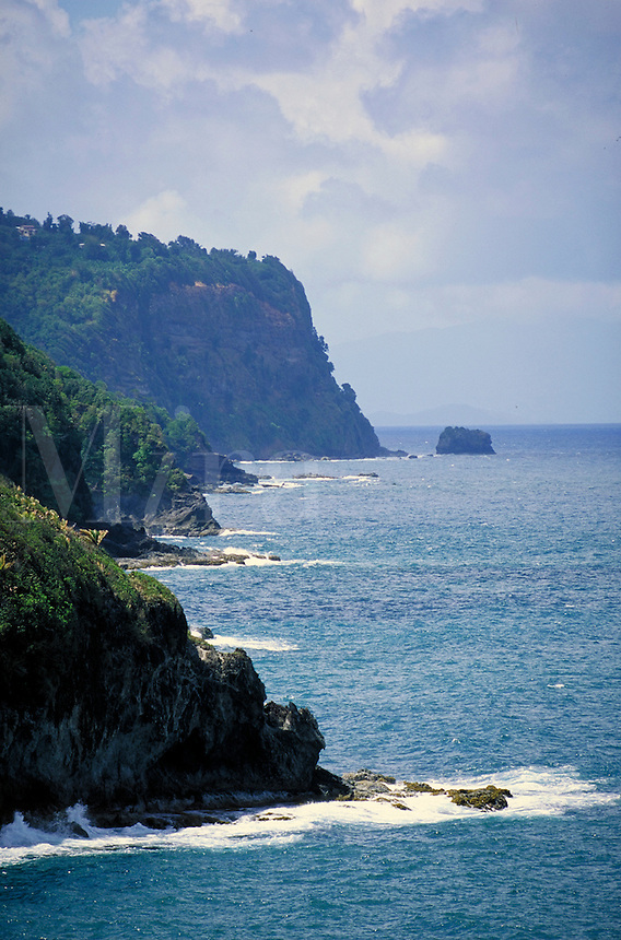 The east coast near the village of Hampstead, island of Dominica , West Indies. Island of Guadaloupe in the background. Village of Hampstead, Dominica West Indies.