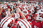 The Wisconsin Badgers football team huddles prior to an NCAA college football game against the Austin Peay Governors on September 25, 2010 at Camp Randall Stadium in Madison, Wisconsin. The Badgers beat the Governors 70-3. (Photo by David Stluka)