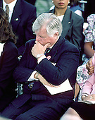 "Arlington, VA - (FILE) -- United States Senator Edward M. ""Ted"" Kennedy (Democrat of Massachusetts) listens to the speeches at a memorial service honoring his slain brother, former U.S. Senator Robert F. Kennedy (Democrat of New York) on the 25th anniversary of his assassination at Arlington National Cemetery on June 6, 1993. .Credit: Howard L. Sachs / CNP"