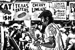 Sax man making music on the street at the Pecan Street Festival in Austin TX.