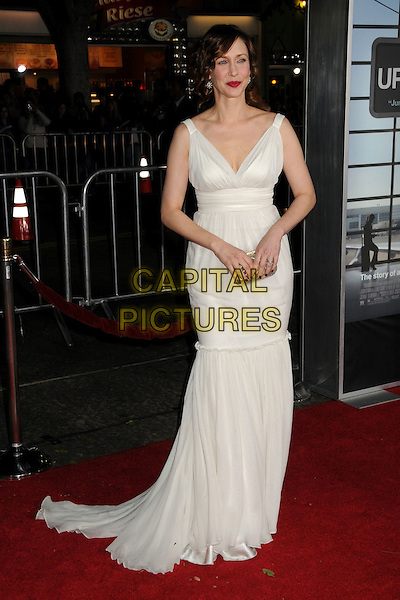 "VERA FARMIGA .Attending the ""Up In The Air"" Los Angeles Premiere held at Mann's Village Theatre, Westwood, California , USA, .30th November 2009..full length long maxi dress gown train sleeveless  white cream gold clutch bag .CAP/ADM/BP.©Byron Purvis/AdMedia/Capital Pictures."