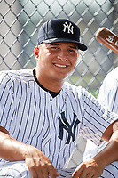 GCL Yankees East starting pitcher Luis Ojeda (3) in the dugout during the first game of a doubleheader against the GCL Blue Jays on July 24, 2017 at the Yankees Minor League Complex in Tampa, Florida.  GCL Blue Jays defeated the GCL Yankees East 6-3 in a game that originally started on July 8th.  (Mike Janes/Four Seam Images)