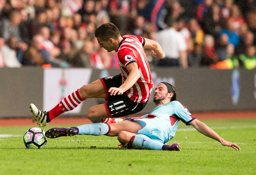 Burnley's George Boyd tackles Southampton's Dusan Tadic<br /> <br /> Photographer James Williamson/CameraSport<br /> <br /> The Premier League - Southampton v Burnley - Sunday 16th October 2016 - St Mary's Stadium - Southampton<br /> <br /> World Copyright &copy; 2016 CameraSport. All rights reserved. 43 Linden Ave. Countesthorpe. Leicester. England. LE8 5PG - Tel: +44 (0) 116 277 4147 - admin@camerasport.com - www.camerasport.com
