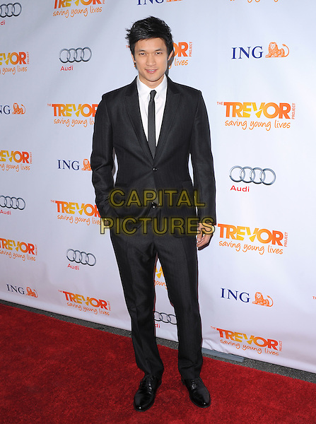 Harry Shum Jr..Trevor Live at The Hollywood Palladium in Hollywood, California, USA..December 4th, 2011  .full length suit hand in pocket black white tie.CAP/RKE/DVS.©DVS/RockinExposures/Capital Pictures.