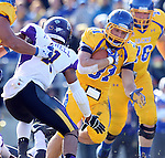 BROOKINGS, SD - OCTOBER 26:  Zach Zenner #31 from South Dakota State University scampers past the defense from Northern Iowa in the second quarter of their game Saturday afternoon at Coughlin Alumni Stadium in Brookings. (Photo by Dave Eggen/Inertia)