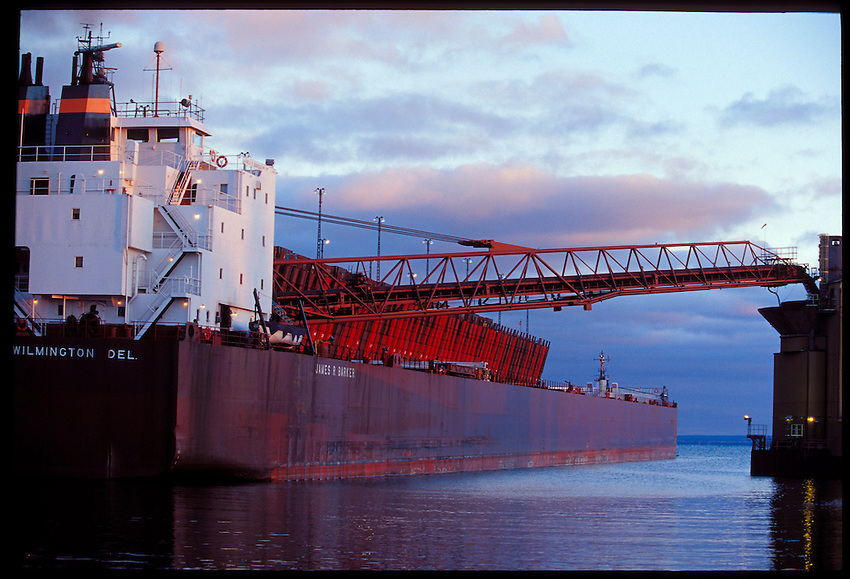 THE FREIGHTER JAMES R. BARKER IS SEEN ON LAKE SUPERIOR UNLOADING COAL WHILE DOCKED AT THE LAKE SUPERIOR & ISHPEMING RAILROAD IRON ORE DOCK IN MARQUETTE, MICHIGAN.