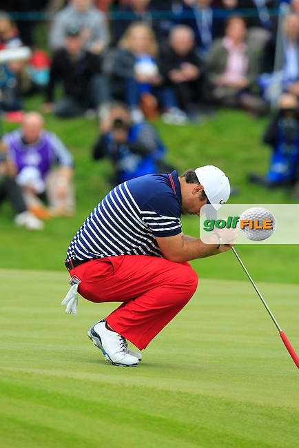 Patrick Reed (USA) misses his putt on the 18th green during Sunday's Singles Matches of the Ryder Cup 2014 played on the PGA Centenary Course at the Gleneagles Hotel, Auchterarder, Scotland.: Picture Eoin Clarke, www.golffile.ie: 28th September 2014