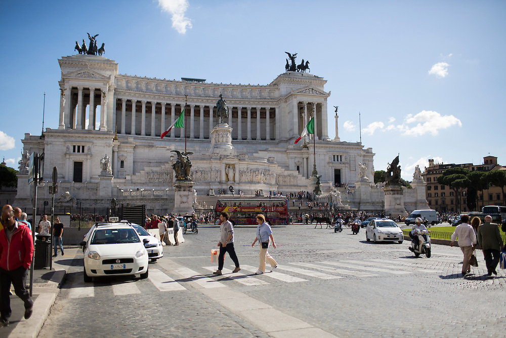 Traffic circles the Piazza Venezia in front of Altare della Patria (Altar of the Fatherland) on Thursday, Sept. 24, 2015, in Rome, Italy. (Photo by James Brosher)