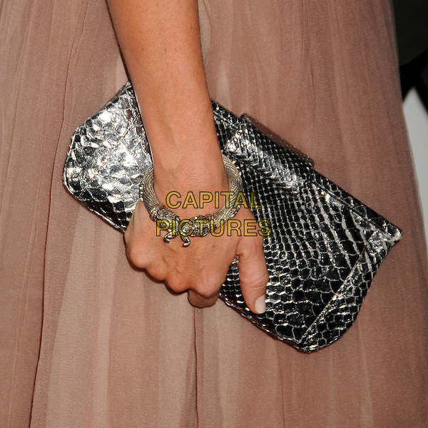TONI COLLETTE's bag .Attending the 2010 G'Day USA Australia Week Black Tie Gala held at the Hollywood & Highland Grand Ballroom, Hollywood, California, USA, .16th January 2010..arrivals detail hand clutch bracelet snake embossed silver .CAP/ADM/BP.©Byron Purvis/Admedia/Capital Pictures