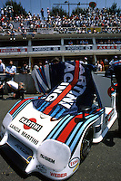 LE MANS, FRANCE - JUNE 17: The Martini Racing Lancia LC2-84 0005 of fastest qualifiers Bob Wollek and Alessandro Nannini is parked on the front straight before the start of the 24 Hours of Le Mans FIA World Sports Car Championship race at the Circuit de la Sarthe in Le Mans, France, on June 17, 1984.