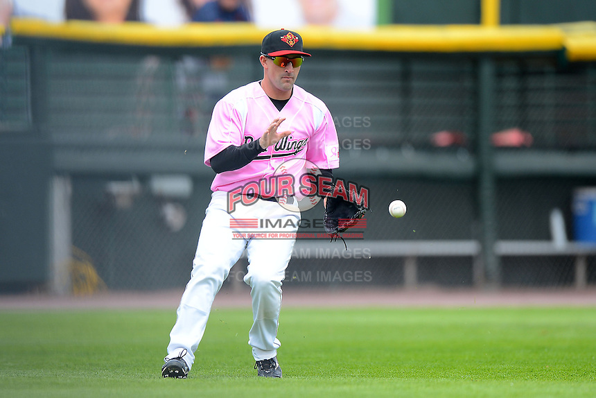 Rochester Red Wings outfielder Brian Dinkelman #12 fields a base hit during a game against the Columbus Clippers on May 12, 2013 at Frontier Field in Rochester, New York.  Rochester defeated Columbus 5-4 wearing special pink jerseys for Mother's Day.  (Mike Janes/Four Seam Images)