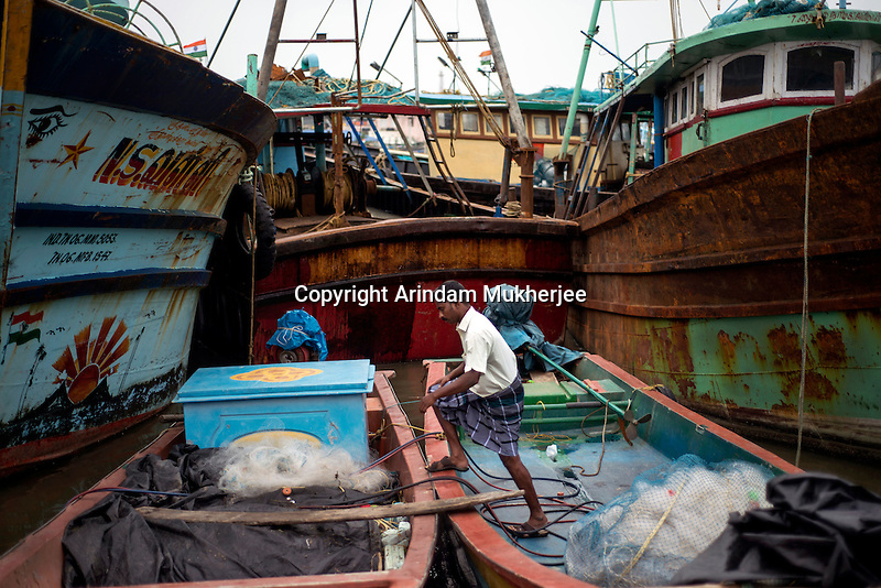 Fishermen on a boat at Kichankuppam fishing port at Nagapattinam. This was one of the most affected areas by 2004 Tsunami in Tamil Nadu, India.