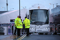 Monday 11th August 2014<br /> Pictured: Real Madrid team bus outside Cardiff City Stadium with UEFA Super Cup stewards standing by.<br /> RE: Real Madrid team bus outside Cardiff City Football Stadium.