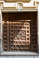 Ancient carved wooden doorway in Santo Domingo de la Calzada in  La Rioja, Spain