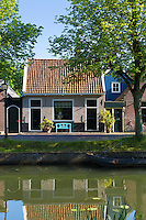 Quaint houses facades alongside the canal waterway in the town of Edam, The Netherlands