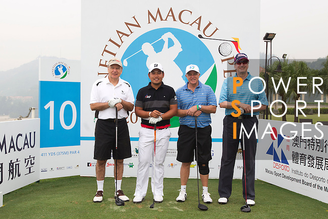 Competitors in action during the Venetian Macau Open golf tournament on October 16, 2013 at the Macau Golf & Country Club in Macau, China. Photo by Alan Siu / The Power of Sport Images