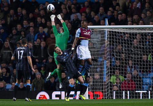04.03.2013 Birmingham, England.  Aston Villa's Christian Benteke and Manchester City's Joe Hart in action during the Premier League game between Aston Villa and Manchester City from Villa Park.