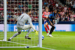 Atletico de Madrid's Antoine Griezmann and Club Brugge's Karlo Letica (L) and Stefano Denswil (R) during UEFA Champions League match between Atletico de Madrid and Club Brugge at Wanda Metropolitano Stadium in Madrid, Spain. October 03, 2018. (ALTERPHOTOS/A. Perez Meca)