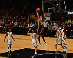 LSU Tiger Freshman Forward Ben Simmons rises up for a powerful dunk against the Marquette Golden Eagles. Simmons recorded a double double of 20 points and 24 rebounds. The Tigers lost to the Golden Eagles on 81 to 80 in the semifinal of the Fan Duel Legends Classic held at the Barclays Center in Brooklyn.