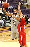 SIOUX FALLS, SD - DECEMBER 8:  Jared Mayes #22 from the University of Sioux Falls takes the ball to the basket against Luis Ricci Maia #11 from Minot State Friday night at the Stewart Center. (Photo by Dave Eggen/Inertia)