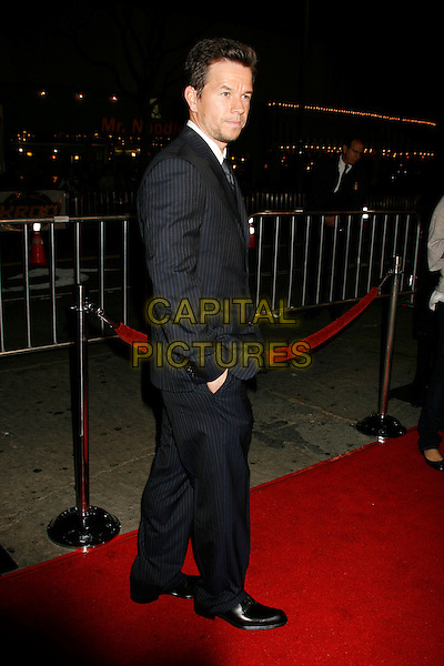 "MARK WAHLBERG.""Shooter"" Los Angeles Premiere held at Mann Village Theatre, Westwood, California, USA,.08 March 2007..full length black suit over shoulder back.CAP/ADM/RE.©Russ Elliot/AdMedia/Capital Pictures."