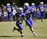 Ryan Cox, left, and Will Thomas Collins make a touchdown at Breathitt County High School on Friday Oct. 14, 2011. The Bobcats beat the Morgan County Cougars 62-8, continuing their undefeated season. Photo by Rachel Aretakis