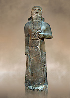 "Neo-Assyrian basalt statue of King Shalmaneser III (858-824 B.C) . Inscription reads ""Shalmaneser, the great king, the mighty king, king of all four region, the powerful and the mighty rival of the princes of the whole earth the great ones, the kings, son of Assur-Nasirapli, King of the universe, King of Assyria, grandson of ~Tukultiu-Ninurta, King of the Universe, King of Assyria"". The inscription continues with his campaigns &b deeds in Uratu, Syria, Que & Tabal ending "" At the time I rebuilt the walls of my city Ashur from their foundations to their summits. I made an image of my royal self and set it up in the metal gate"". From Assur ( Qala't Sharqat) Iraq. Istanbul Archaeological Museum, Inv no. 4650."