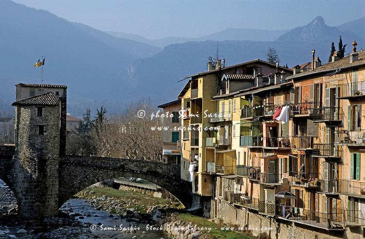 Apartment building and medieval bridge along a river in Sospel, Alpes-Maritimes, France.