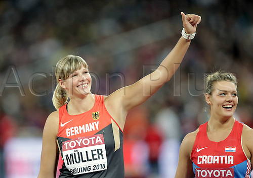 25.08.2015. Beijing, China.  Bronze medalist Nadine Mueller (L) ofGermany celebrates with silver medalist Sandra Perkovic of Croatia after the the women's discus final of the Beijing 2015 IAAF World Championships at the National Stadium, also known as Bird's Nest, in Beijing, China, 25 August 2015.