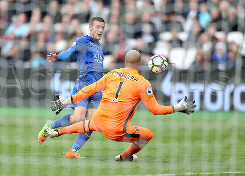 March 18th 2017, The London Stadium, East London, England; EPL Premier League football, West Ham versus Leicester City; Jamie Vardy of Leicester City shot is saved by Goalkeeper Darren Randolph the West Ham United