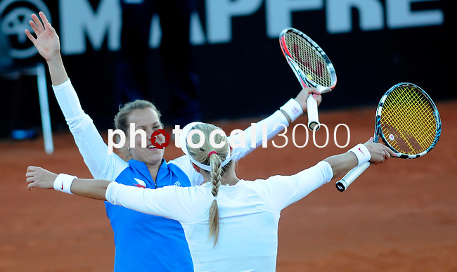 Czech Republic's pair Barbora Zahalavova Strycova(L) and Andrea Hlavackova(R) celebrates the victory to Spain's Silvia Soler Espinosa and Carla Suarez Navarro on their women's doubles match of their 2014 International Tennis Federation Fed Cup World Group first-round tie at the Blas Infante tennis centre in Sevilla on February 10, 2014. Czech Republic's pair won doubles 6-7(7),3-6 and the tie 2-3. <br /> PHOTOCALL3000 / GL