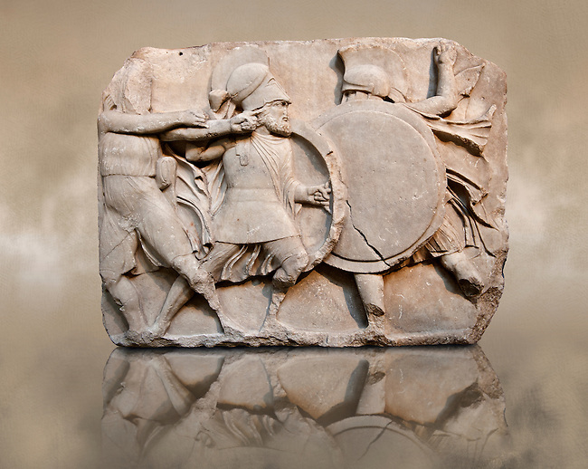 Two warriors clasing shields on a freeze from the Large Podium of the sculptured  4th cent. B.C Lycian Nereid ( Mythical Greek Sea Nymphs) Monument tomb of Arbina, a Xanthian client ruler of the Persians conquerors of Lycia. From Xanthos UNESCO World Heritage site, south west Turkey. British Museum exhibit excavated by Charles Fellows in 1840s.