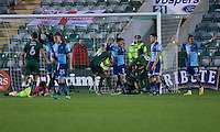 Plymouth players celebrate their third goal while Wycombe players protest during the Sky Bet League 2 match between Plymouth Argyle and Wycombe Wanderers at Home Park, Plymouth, England on 26 December 2016. Photo by Mark  Hawkins / PRiME Media Images.