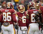 Washington Redskins quarterback Mark Sanchez (6) discusses strategy with tight end Jordan Reed (86) and tight end Vernon Davis (85) in the first quarter of the game against the Washington Redskins at FedEx Field in Landover, Maryland on Sunday, December 9, 2018.  The Giants won the game 40 - 16.<br /> Credit: Ron Sachs / CNP<br /> (RESTRICTION: NO New York or New Jersey Newspapers or newspapers within a 75 mile radius of New York City)