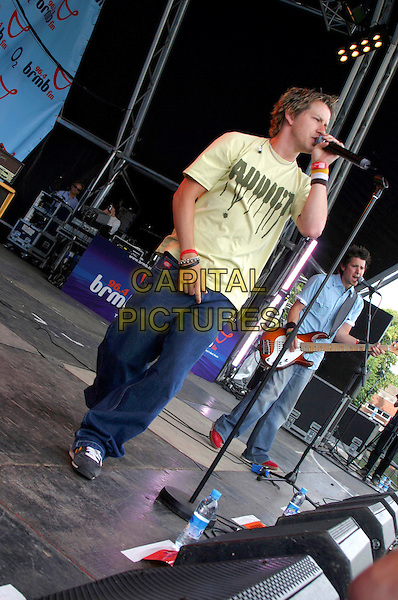 FREEFALLER - OLLIE.Performs Live in Concert at .96.4 BRMB's Party In The Park, .Cannon HIll Park, Birmingham, .July 3rd 2005..full length gig yellow addict slogan t-shirt t shirt top.Ref: JEZ.www.capitalpictures.com.sales@capitalpictures.com.©Jez Self/Capital Pictures