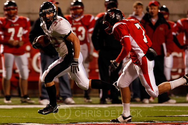 Chris Detrick  |  The Salt Lake Tribune .Hurricane's Jarom Healey #33 runs past Delta's Braden Schouten #7 for a touchdown during the first half of the 3A Semi-final game at Rice-Eccles Stadium Thursday November 11, 2010.