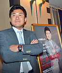 June 29, 2012, Tokyo, Japan - Chairman and CEO HIroshi Mikitani of Rakuten, Japans major Internet shopping site operator, poses next to his own picture at Tokyo Foreign Correspondents Club of Japan on Friday, June 29, 2012..Mikitani stunned the Japanese business community when he announced in July 2010 that English would become the official language at his company by the middle of 2012, as the company expands aggressively overseas. The policy has required the group's 6,000 employees to have English communication abilities. And now other Japanese companies inclding Uniqlo follow suit in Rakutens Englishnization initiative. (Photo by Natsuki Sakai/AFLO).