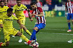 Alvaro Gonzalez of Villarreal competes for the ball with Yannick Ferreira Carrasco of Atletico de Madrid during the match of La Liga between Atletico de Madrid and Villarreal at Vicente Calderon  Stadium  in Madrid, Spain. April 25, 2017. (ALTERPHOTOS/Rodrigo Jimenez)