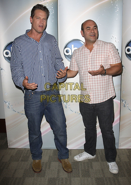 BRIAN VAN HOLT & IAN GOMEZ.Disney/ABC Television Group Press Junket held At The ABC Television Network Building, Burbank, California, USA..May 15th, 2010.full length jeans denim blue check shirt white pink gingham check hands.CAP/ADM/KB.©Kevan Brooks/AdMedia/Capital Pictures.