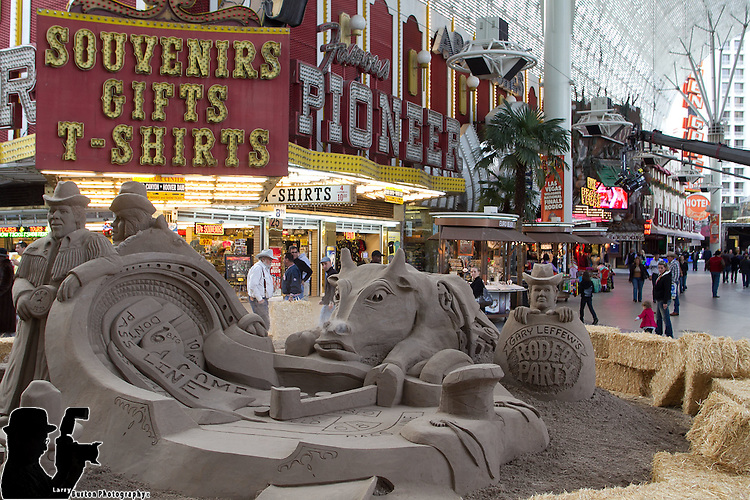 "Travel channel films ""Sand Masters"" on Fremont Street Experience, with 50 tons of sand for a rodeo-inspired sand sculpture."