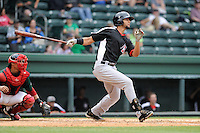 Outfielder Nomar Mazara (12) of the Hickory Crawdads bats in a game against the Greenville Drive on Sunday, June 9, 2013, at Fluor Field at the West End in Greenville, South Carolina. Mazara is the No. 16 prospect of the Texas Rangers, according to Baseball America. The catcher is the Drive's Jayson Hernandez. Hickory won, 6-3. (Tom Priddy/Four Seam Images)