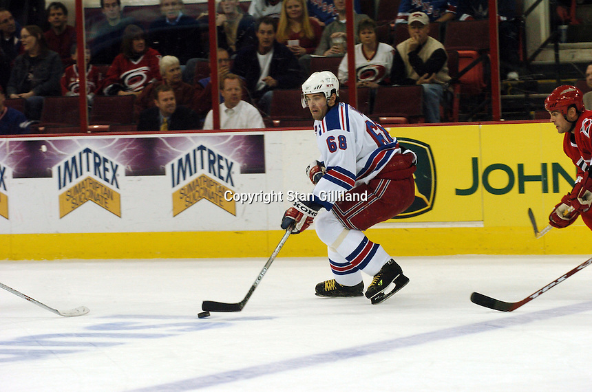 New York Rangers' Jaromir Jagr of the Czech Republic carries the puck during a game with the Carolina Hurricanes Tuesday, March 14, 2006 at the RBC Center in Raleigh, NC. Carolina won 5-3.