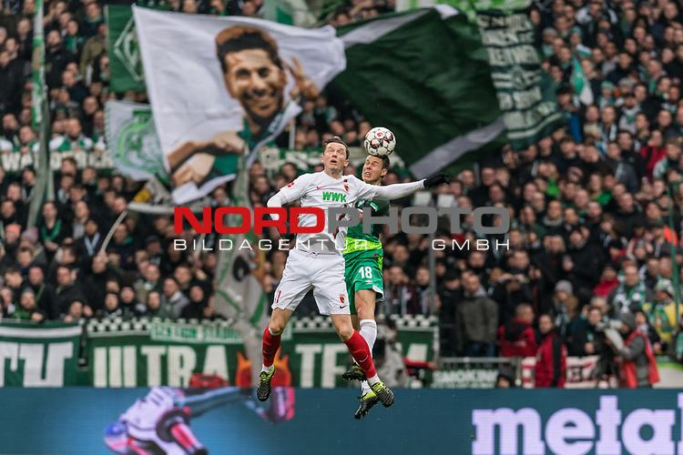 10.02.2019, Weserstadion, Bremen, GER, 1.FBL, Werder Bremen vs FC Augsburg<br /> <br /> DFL REGULATIONS PROHIBIT ANY USE OF PHOTOGRAPHS AS IMAGE SEQUENCES AND/OR QUASI-VIDEO.<br /> <br /> im Bild / picture shows<br /> Michael Gregoritsch (FC Augsburg #11) im Duell / im Zweikampf mit Niklas Moisander (Werder Bremen #18), <br /> <br /> Foto © nordphoto / Ewert