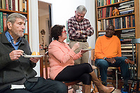 """Former Massachusetts governor Michael Dukakis (center, standing, speaks with Barrie Baker (left center seated) and her husband Jimmie Baker, Jr., of Waltham, Mass., after a meeting of a support group for people who have had electroconvulsive therapy (ECT) led by Dukakis and his wife Kitty Dukakis in their home in Brookline, Massachusetts, USA, on Sun., Dec. 4, 2016. Kitty Dukakis used ECT to treat depression and substance abuse issues. She continues to have ECT treatments about once every seven or eight weeks. It was the Bakers' first time attending the support group. A family practitioner, Barrie Baker said during the meeting that """"ECT saved my life twice."""""""