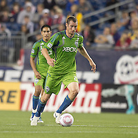 Seattle Sounders forward Nate Jaqua (21) at midfield. In a Major League Soccer (MLS) match, the Seattle Sounders FC defeated the New England Revolution, 2-1, at Gillette Stadium on October 1, 2011.