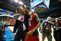 PITTSBURGH, PA - MARCH 21: Head coach Mark Gottfried walks off the floor with Anthony Barber #12 of the North Carolina State Wolfpack following their 71-68 win over the Villanova Wildcats during the third round of the 2015 NCAA Men's Basketball Tournament at Consol Energy Center on March 21, 2015 in Pittsburgh, Pennsylvania.  (Photo by Jared Wickerham/Getty Images)