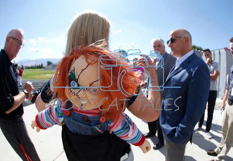 Wooster High School Principal Leah Keuscher wears her Raiders and a Chucky doll to welcome Raiders president Marc Badain on a tour of the campus on Thursday, Aug. 16, 2018. The Raiders are considering several potential training camp locations in Reno. (Cathleen Allison/Las Vegas Review-Journal)
