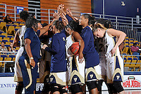 11 November 2011:  FIU's team gathers prior to starting the second half as the FIU Golden Panthers defeated the Jacksonville University Dolphins, 63-37, at the U.S. Century Bank Arena in Miami, Florida.