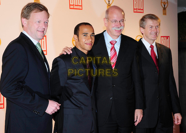 "GUEST, LEWIS HAMILTON, DIETER ZETSCHE & GUEST.The ""Das Goldene Lenkrad"" award ceremony, Berlin, Germany..November 5th, 2008.the golden steering wheel half length black suit jacket blue glasses .CAP/PPG/NK.©Norbert Kesten/People Picture/Capital Pictures"