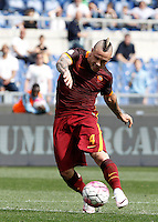 Calcio, Serie A: Lazio vs Roma. Roma, stadio Olimpico, 3 aprile 2016.<br /> Roma's Radja Nainggolan kicks the ball during the Italian Serie A football match between Lazio and Roma at Rome's Olympic stadium, 3 April 2016.<br /> UPDATE IMAGES PRESS/Isabella Bonotto